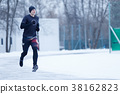 Photo of running athlete in black clothes at 38162823