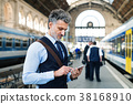 Mature businessman with smartphone on a train 38168910