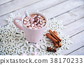 Mug of hot chocolate with marshmallows on table 38170233