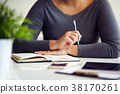 Woman working in office with her diary 38170261