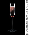 Rose pink champagne glass with bubbles on black 38171930