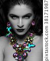 Beautiful woman wearing exotic luxury jewelry 38171987