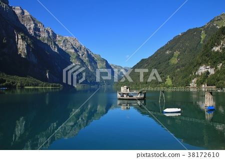 Clear blue summer day at lake Klontalersee.  38172610