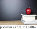 Red apple on book with Blackboard (Chalk Board) 38174062