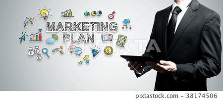 Marketing Plan with man holding tablet computer 38174506