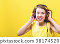 Happy young woman with headphones 38174520