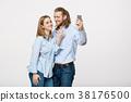 Joyful young loving couple making selfie on camera 38176500