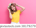 Beauty woman posing with flower hat 38179279