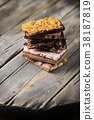Mix of sweet swiss choccolate on the wooden table 38187819