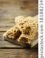 Energy bars with dryed fruits on the wooden table 38188234