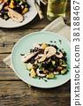 Black rice with prawns, vegetables and orange 38188467