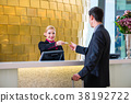 Hotel receptionist check in man giving key card 38192722