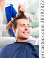 Hairdresser advice man on haircut in barbershop 38192872