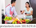 kitchen,couple,wine 38192916