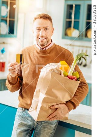 Positive happy man buying food online 38193518