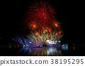 Beautiful fireworks in the night sky. 38195295