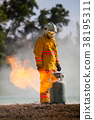 Firefighter with fire and suit for protect fire. 38195311