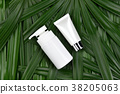 Cosmetic bottle containers with green herbal leave 38205063