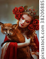 Woman in medieval clothes with a fox 38206885