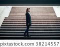 Lonely beautiful woman standing on underground stairs 38214557