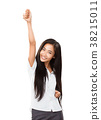 Asian young woman rejoices at her success or victory 38215011