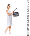 Beautiful young Asian woman holding cinema clapper board isolated 38215054