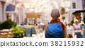 Photo from back of tourist woman with backpack 38215932