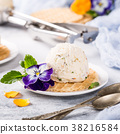 Vanilla ice cream with edible flowers 38216584