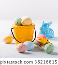 Easter composition with quail eggs and tulips 38216615