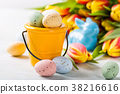 Easter composition with quail eggs and tulips 38216616