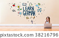 Learn German text with little girl using a laptop 38216796