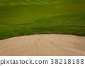Green golf course in summer time 38218188