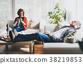 Senior couple relaxing at home. 38219853