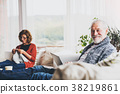 Senior couple relaxing at home. 38219861