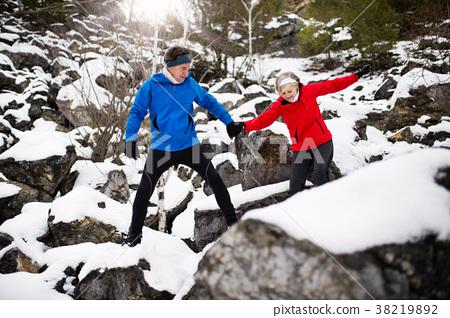 Senior couple jogging in winter nature. 38219892