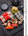 Japanese cuisine. Sushi set over dark background. 38220725