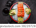 Japanese cuisine. Salmon sushi on ice. 38220728
