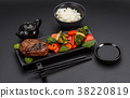 Asian food. Rice with steak and vegetables. 38220819