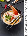 Crab soup over dark background. 38220830