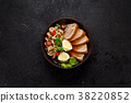 Ramen soup over dark background. 38220852