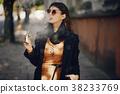 stylish girl smoking an e-cigarette 38233769