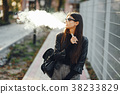 stylish girl smoking an e-cigarette 38233829