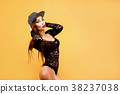 Sexy model with long hair in fashion cap and lace 38237038