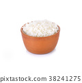 Rice in a bowl on a white background 38241275