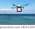 Rescue drone with lifebuoy flying over the ocean.  38241360
