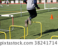 Athlete jumping over yellow hurdles 38241714