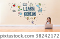 Learn Korean text with little girl using a laptop 38242172
