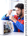 Young repairman fixing and repairing microwave 38250535