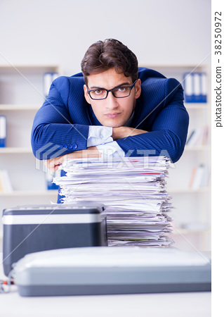 Businessman making copies in copying machine 38250972