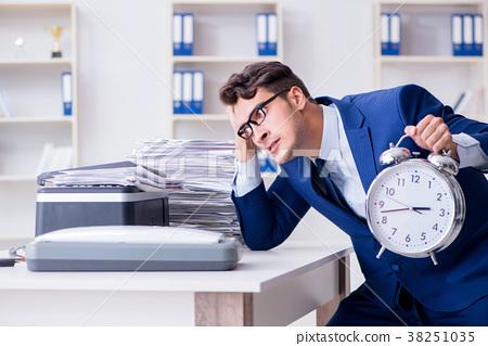 Businessman making copies in copying machine 38251035